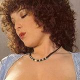 Busty retro lady giving a titjob