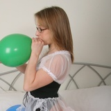 Wench in nylons blowing up balloons