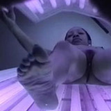 Ebony beauty gets her pussy captured on spy cam while working on her tan in a solarium.