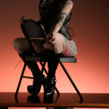 tattooed shaved guerilla girl corset high heels