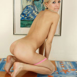 Blonde teen spreads her legs wide open and posing so hot on the table
