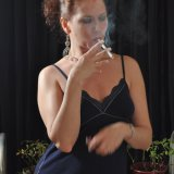 Sexy Smoking Mina in blue dress stripping
