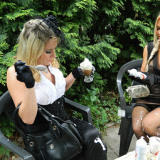 Fetish loving blondes fondling muffs in the garden