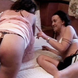 Hot babe Sally enjoys spanking Steff until her ass is red and sore in the bedroom