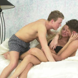Pretty blonde goes all out in this hot bisexual threesome and enjoys cum swapping with two guys