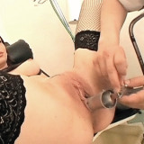 Hot chick Michelle has her ass finger fucked and checked by her gloved doctor