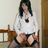 Horny crossdresser Kirsty gets home for the office and is ready for some hot dildo action on the bed