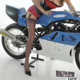 Fast bikes and nylon stockings, now that's something a woman like Jane loves to have between her long silky legs