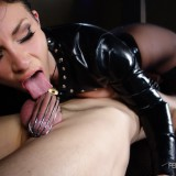 Mistress Andy San Dimas plays with her slave's chastised cock as he worships her pussy.
