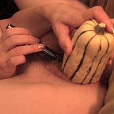 A pretty pearl necklace and huge vegetable help Naughty Tinkerbell orgasm hard as she fucks her hairy pussy