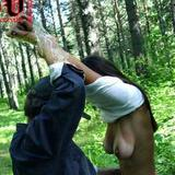 Student girl tied up in forest