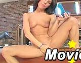 Hot brunette masturbates with a toy
