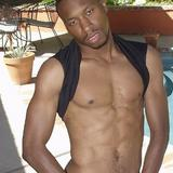 Hot black brutha strips poolside